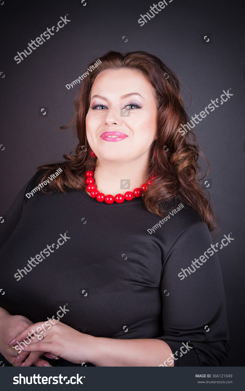 Beautiful buxom girl in the large black… Stock Photo 366121049 ...