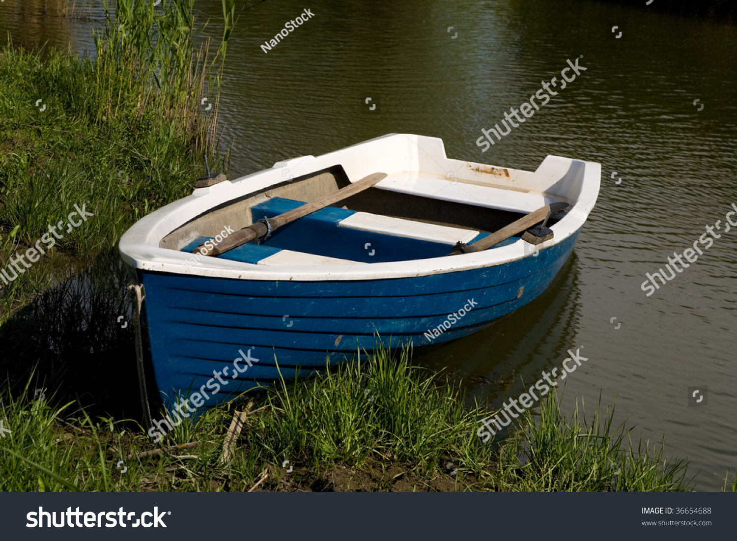 Small fishing boat moored pond along stock photo 36654688 for Pond fishing boats