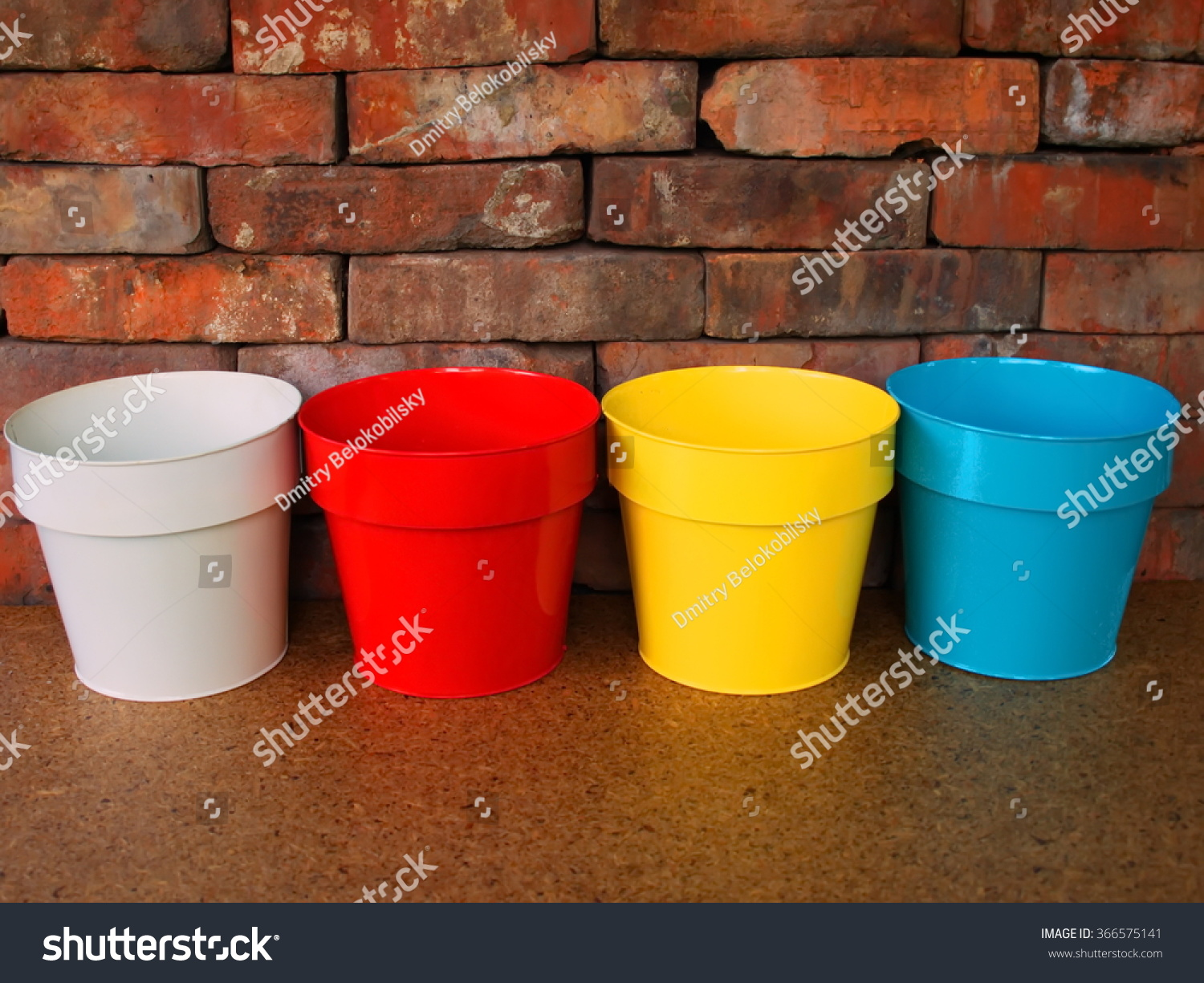 Colorful Flower Pots On Brick Wall Stock Photo 366575141 - Shutterstock