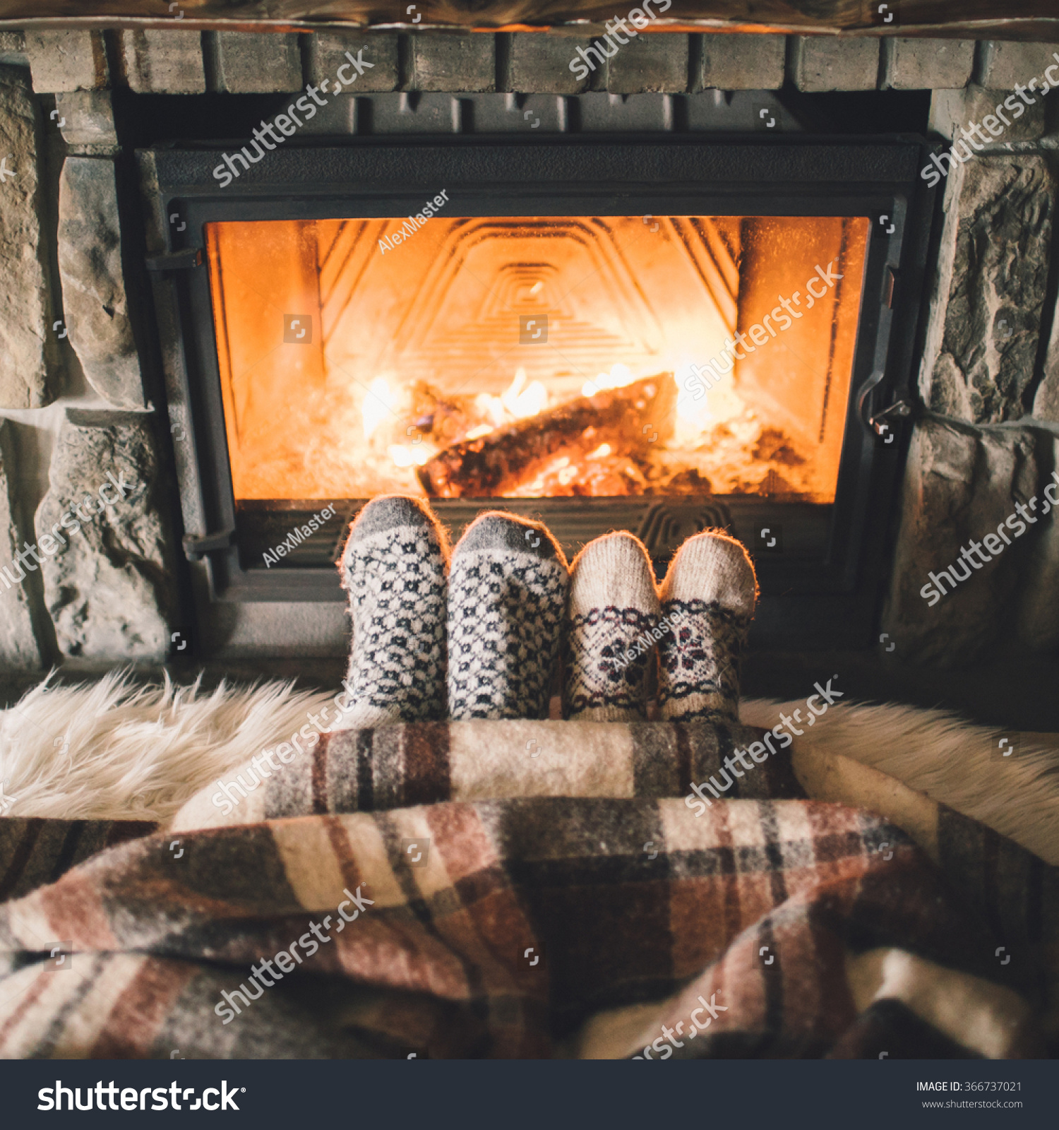 feet woollen socks by christmas fireplace stock photo 366737021