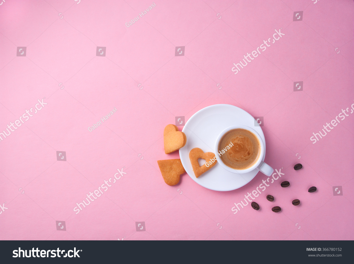 stock-photo-cup-of-coffee-on-pink-paper-
