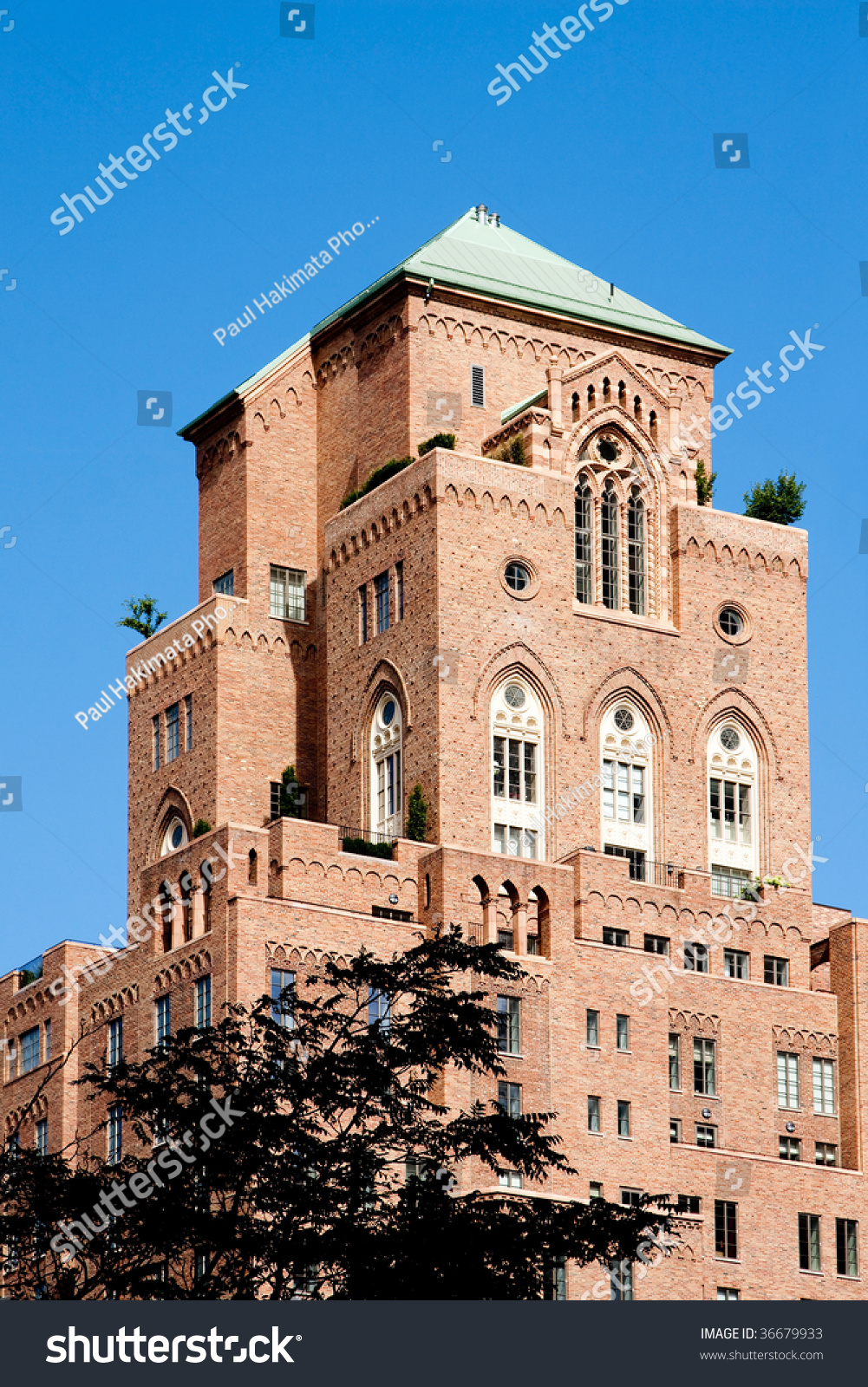 Old Style Architecture Brick Apartment Building With Gothic Arched