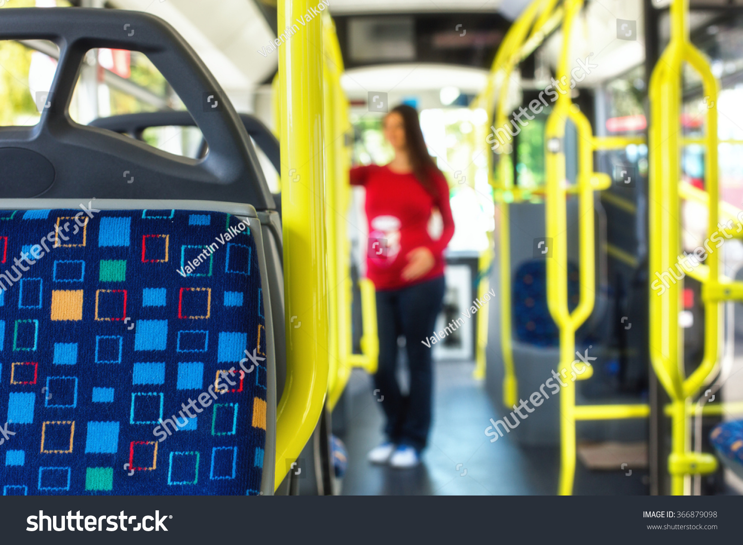 Silhouette of a pregnant woman travelling with public autobus or tramway during her commute to work school