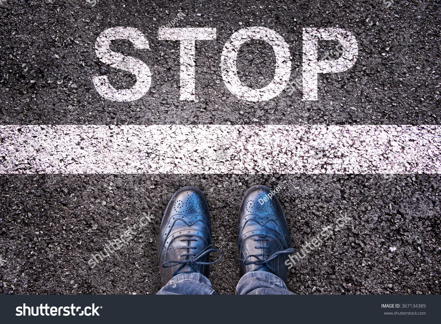 Word Stop written on an asphalt road with legs and shoes #367134389