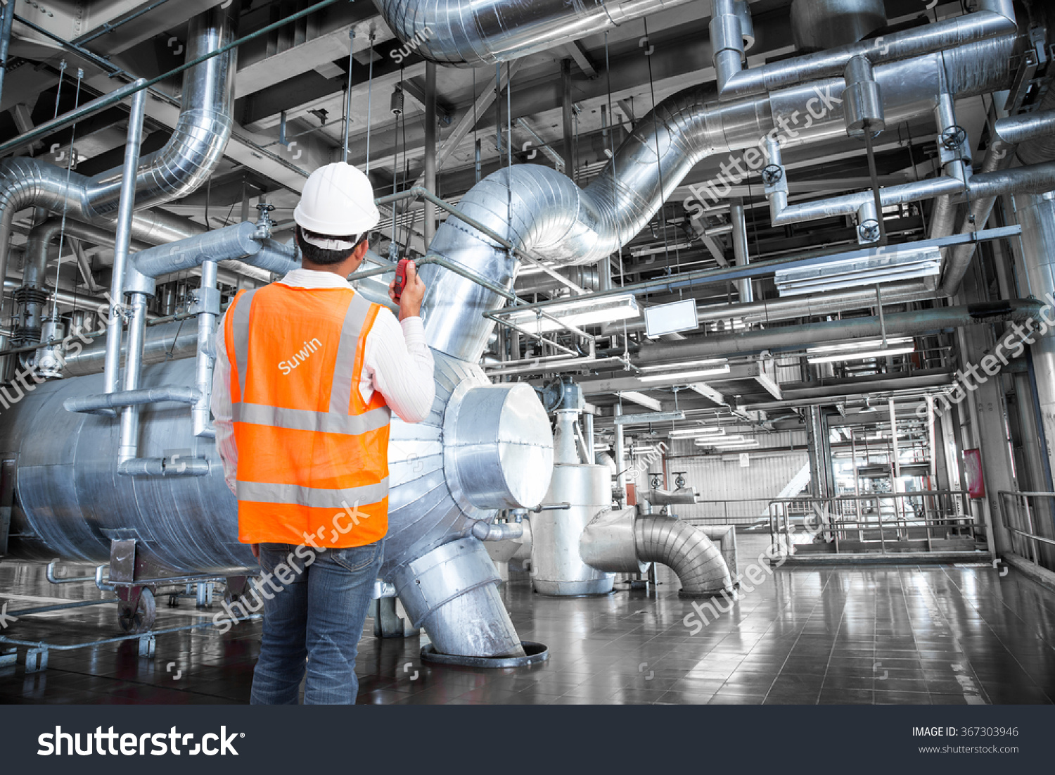 engineer working in a thermal power plant with talking on the walkie talkie for controlling - Power Plant Engineer