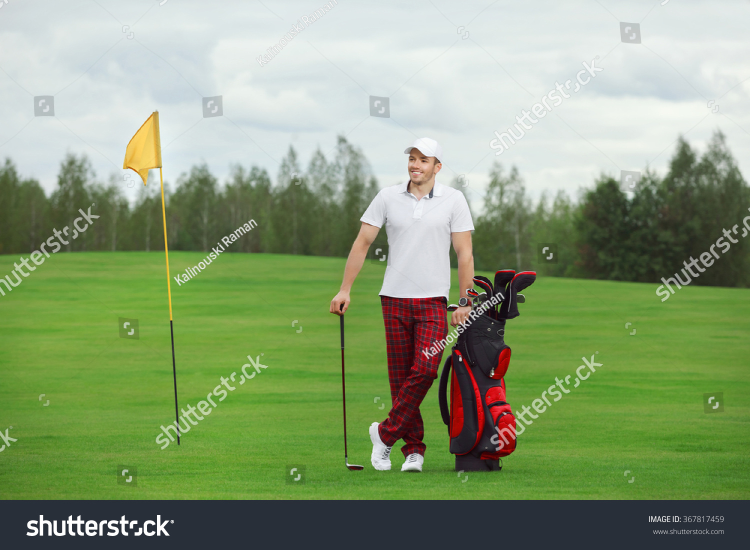 dea9bb90fd0 Golf is a style of living. Golf player in trucker hat walking and carrying  red