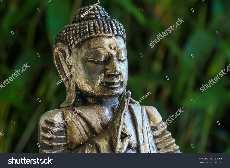 Golden buddha statue meditating while making stock photo 367935068 golden buddha statue meditating while making the symbolic abhaya mudra finger gesture right hand raised buycottarizona