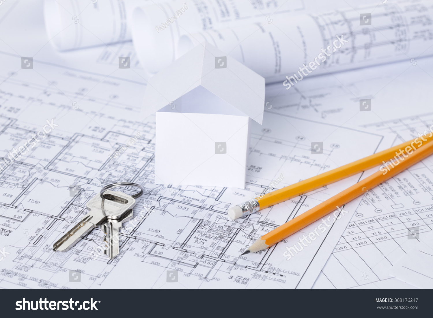 Architectural project blueprints blueprint rolls and divider architectural project blueprints blueprint rolls and divider compass calipers folding ruler on plans engineering tools view from the top copy space malvernweather Choice Image