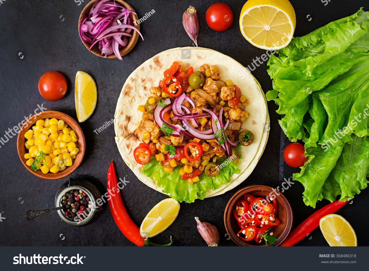 Mexican tacos with meat corn and olives on dark background Top view