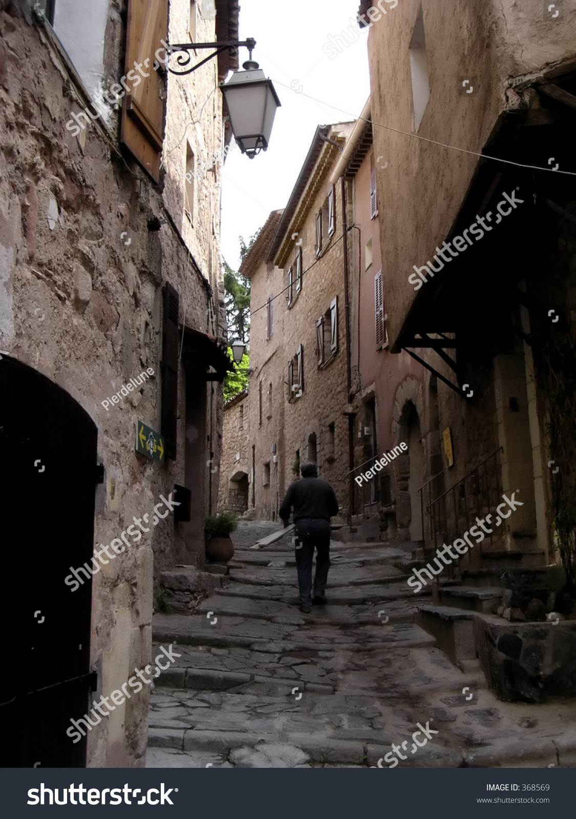 old french worker in a street of les arcs sur argens provence france medieval hamlet stock. Black Bedroom Furniture Sets. Home Design Ideas
