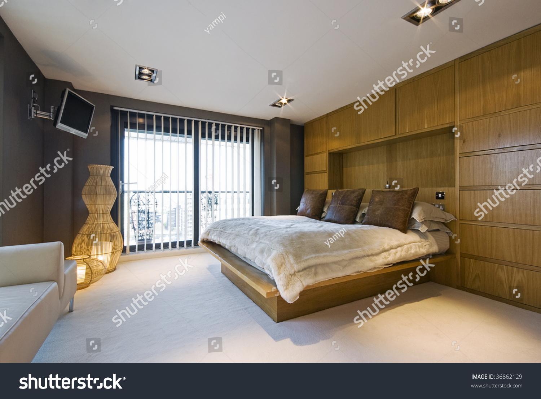 stunning luxury bedroom king size bed stock photo 36862129. Black Bedroom Furniture Sets. Home Design Ideas