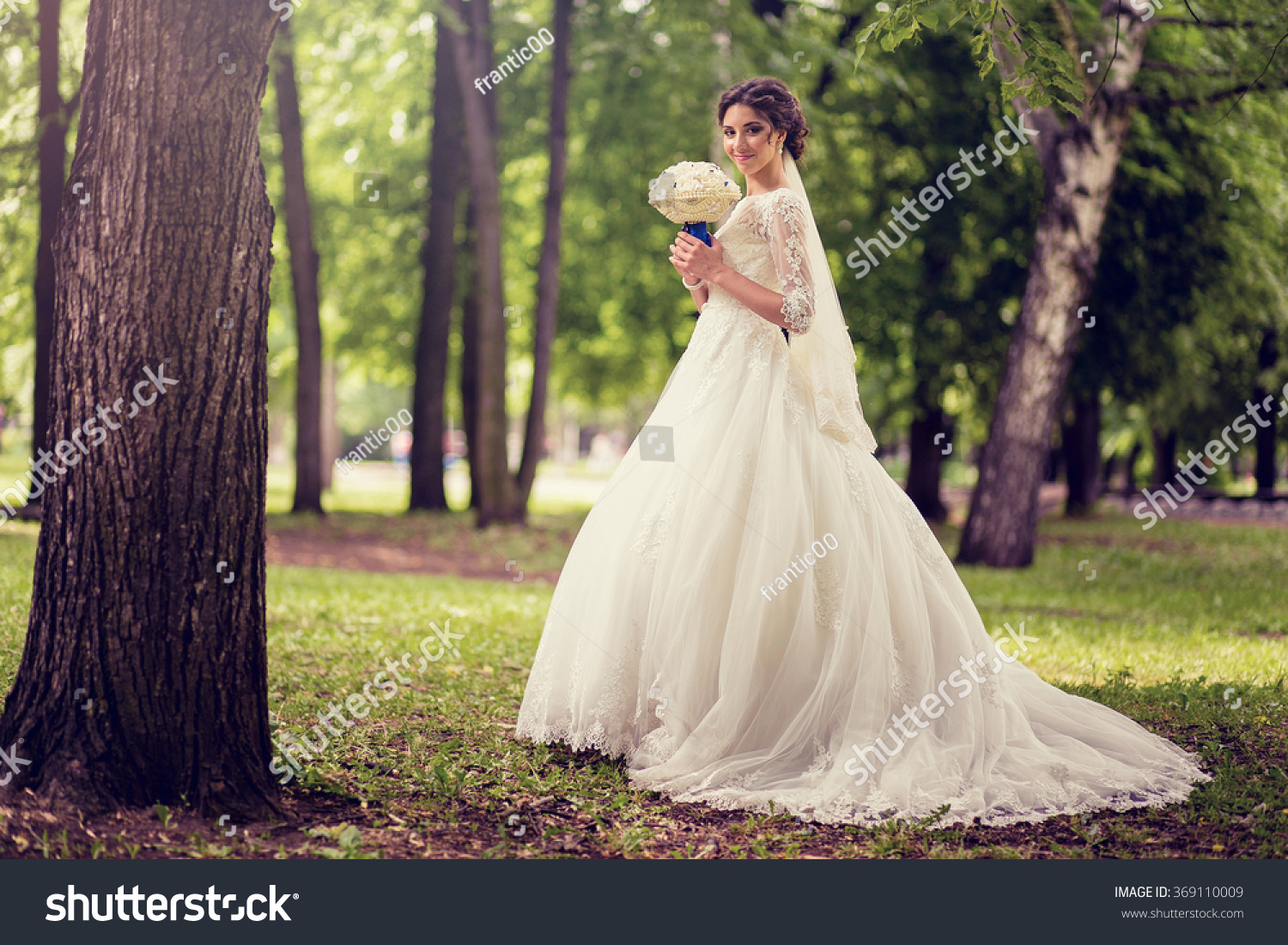 Elegant Bride In Wedding Dress With Dipped Hem Full Length On A Background Of: Forest Dipped Wedding Dresses At Websimilar.org
