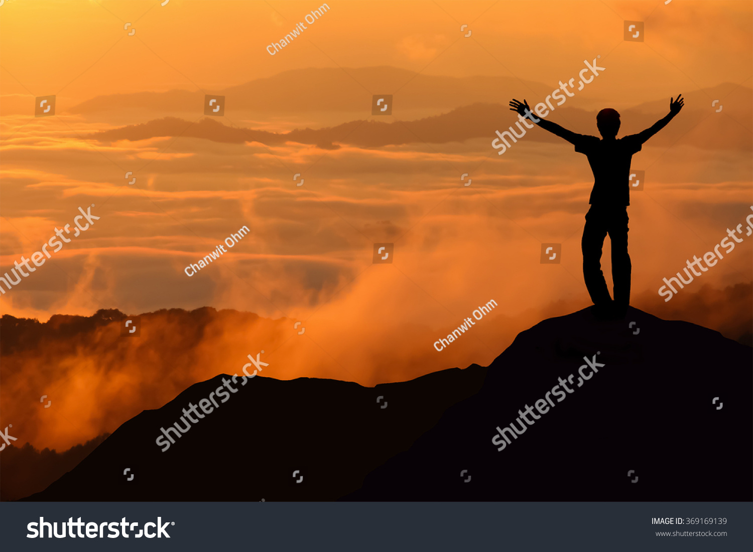 Silhouette Of Tourist Man Spread Hand On Top Of A Mountain - This man hikes up the transylvanian mountains every morning to photograph sunrise