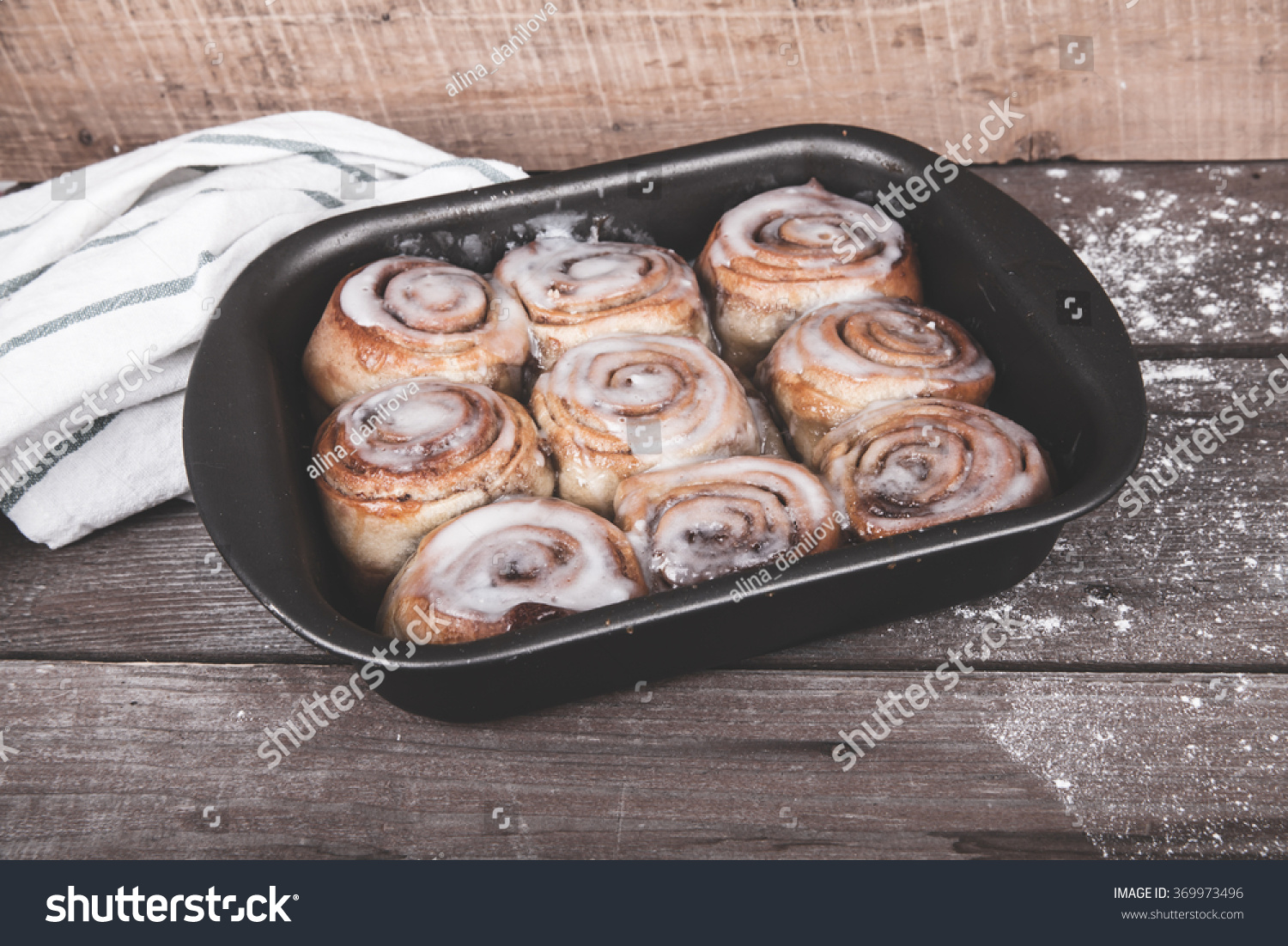 Cinnabon on a wooden background #369973496