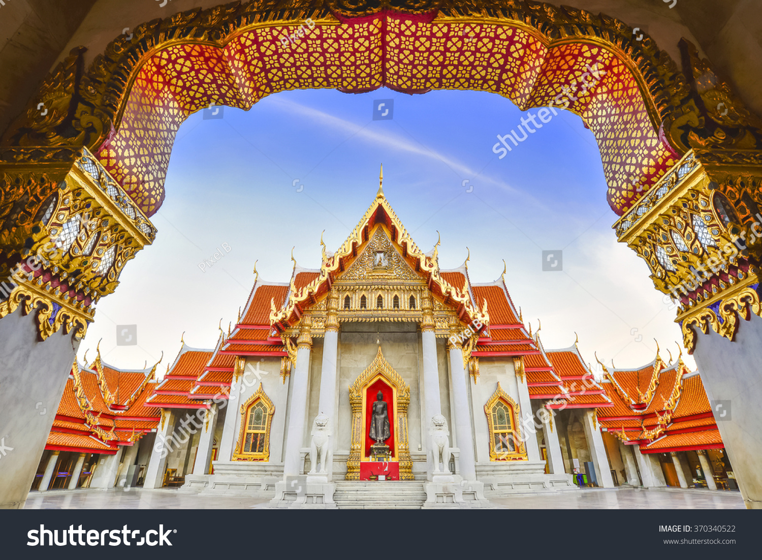 Beautiful marble temple at Bangkok city Thailand with the twilight scene from the entrance view