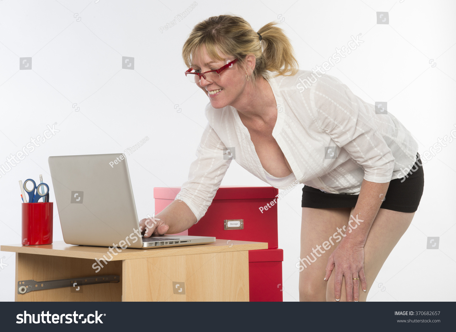 sexy secretary plunging neckline working her stock photo (royalty