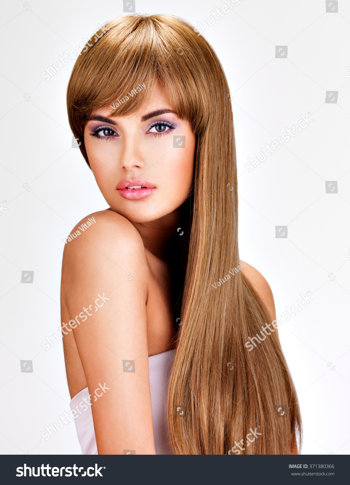 Portrait Of A Beautiful Indian Woman With Long Straight Brown Hair