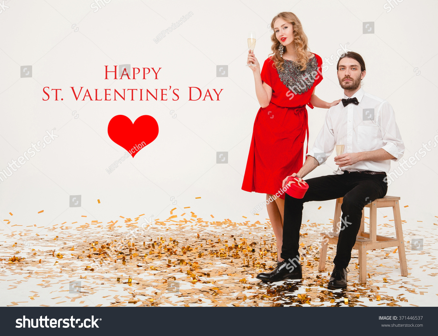3502b3103a0 young stylish couple in love on white background holding glasses and  drinking champagne