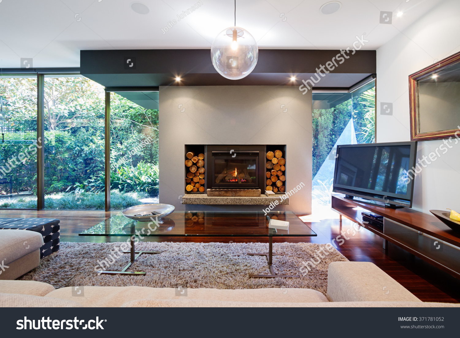 warm australian living room fireplace contemporary stock photo