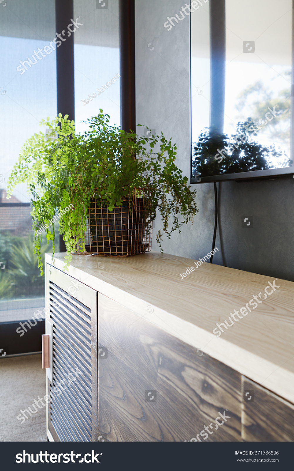 Bedroom Buffet With Copper Wire Basket Indoor Plant On Buffet With Wall  Mounted Tv Above