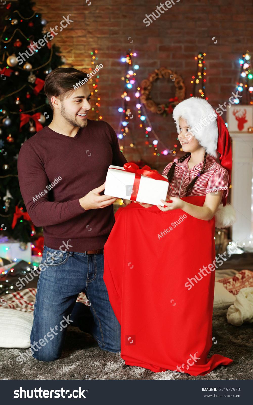 Little Sister Santa Sack Giving Gift Stock Photo (Edit Now ...
