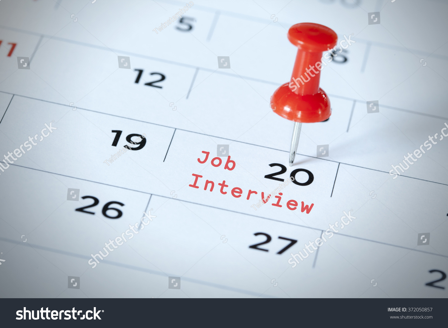 Calendar Photography Jobs : Job interview being pinned on calendar stock photo
