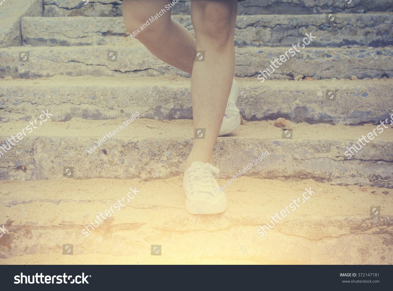 Closeup Man Sneaker Shoes Walking Down Stock Photo