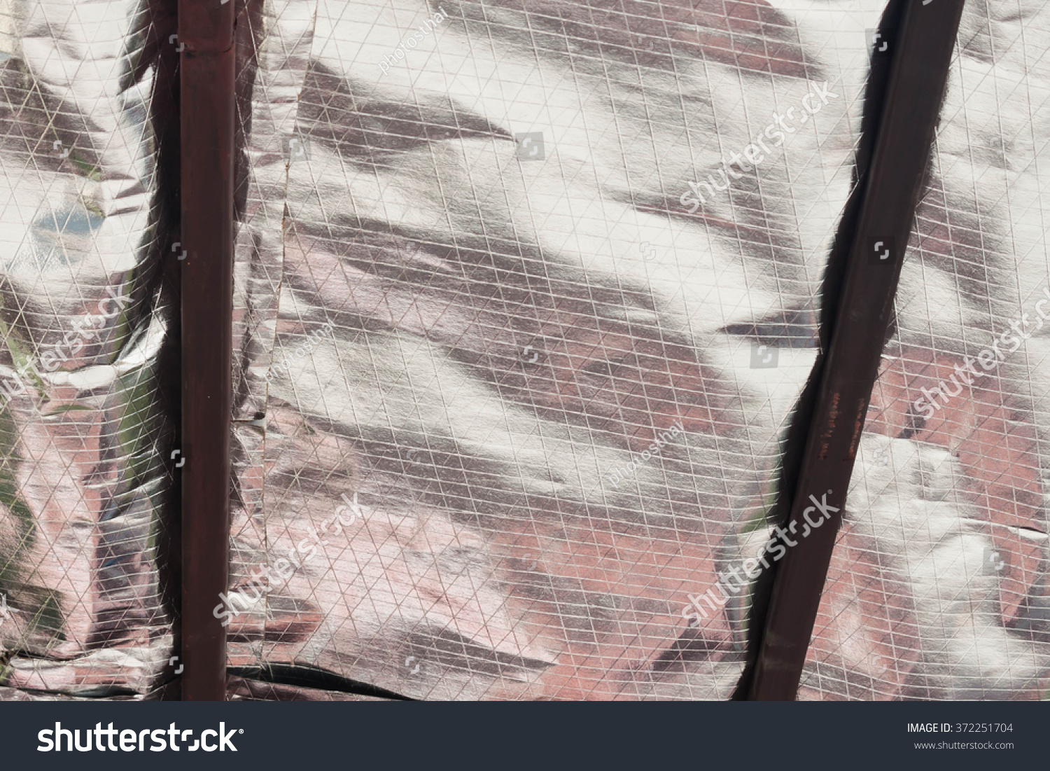 Install Aluminum Foil Sheet Insulation Under Stock Photo