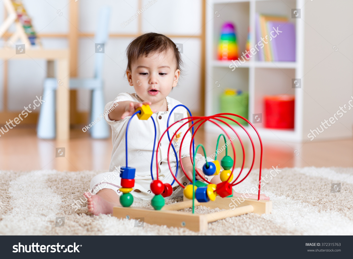 Educational Toys Nursery : Baby girl playing educational toy nursery stock photo