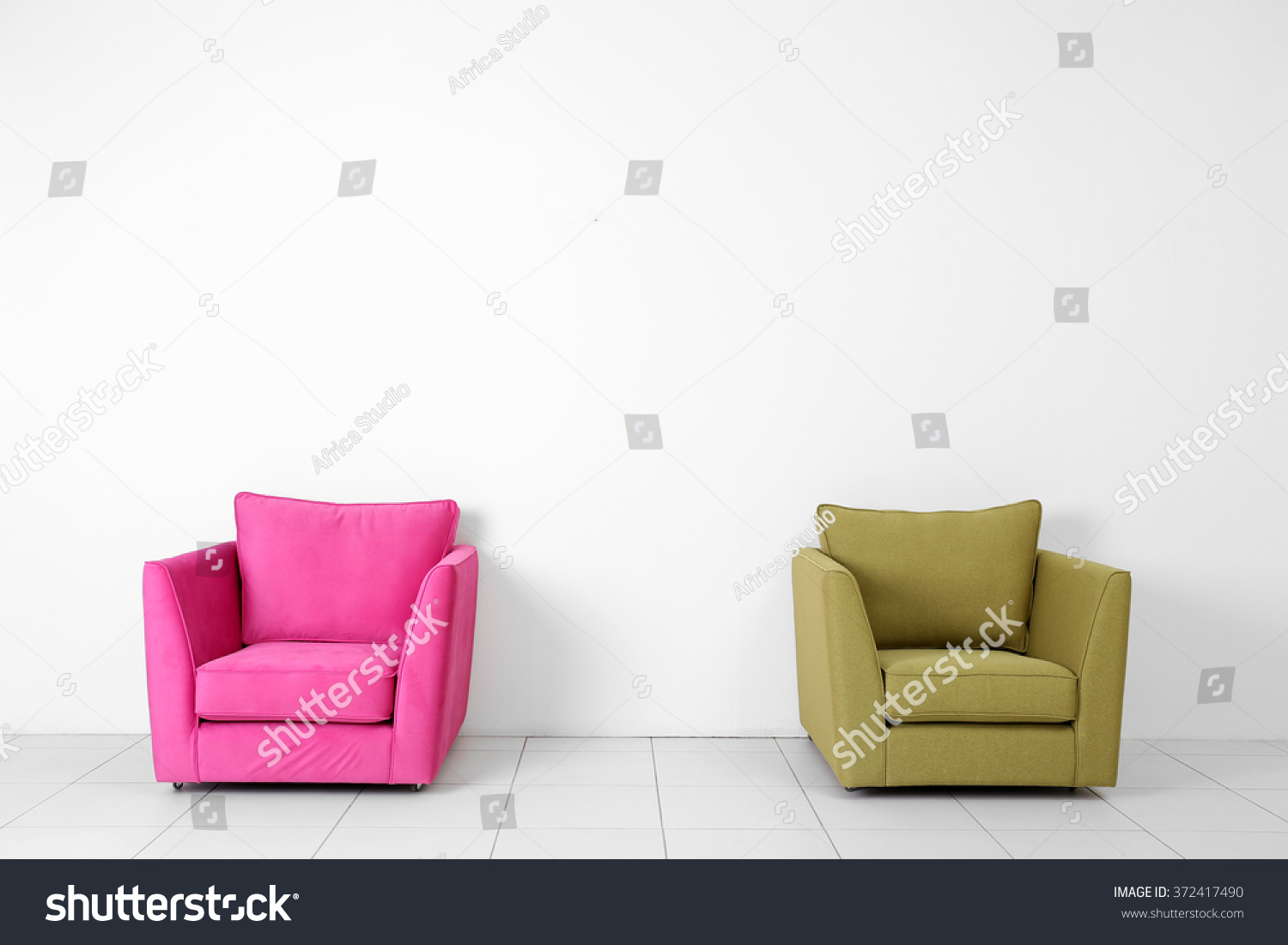 Living Room Interior With Pink And Green Armchairs On White Wall Background