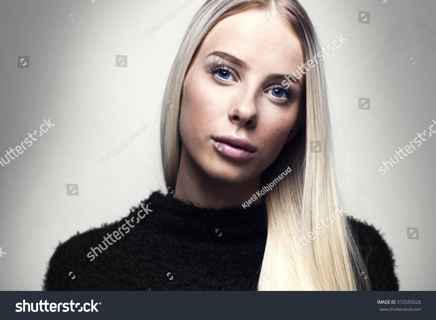 Portrait of a young blonde woman with hairy jacket