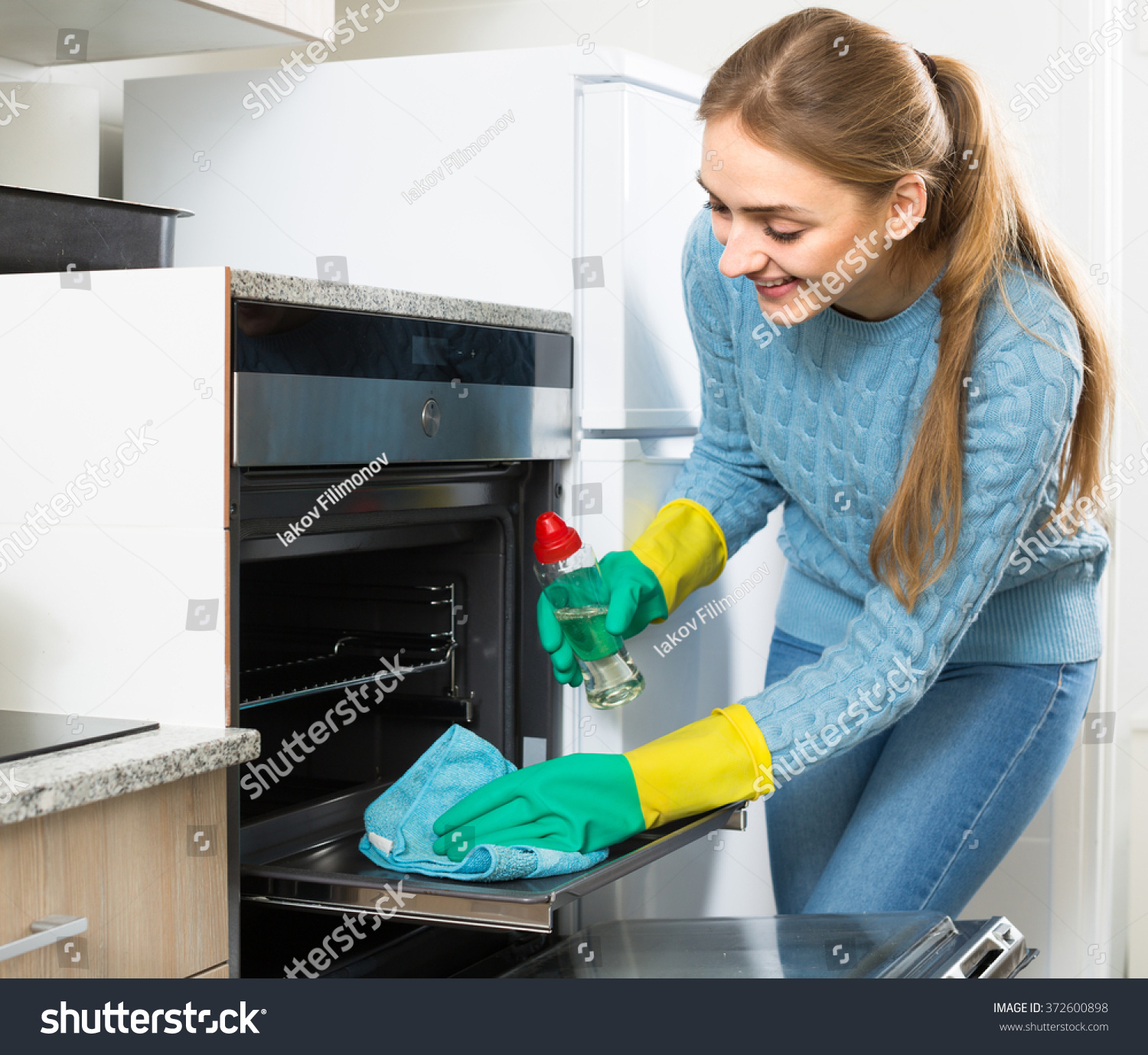 Young Maid Doing Oven Cleanup Domestic Stock Photo (Download Now ...