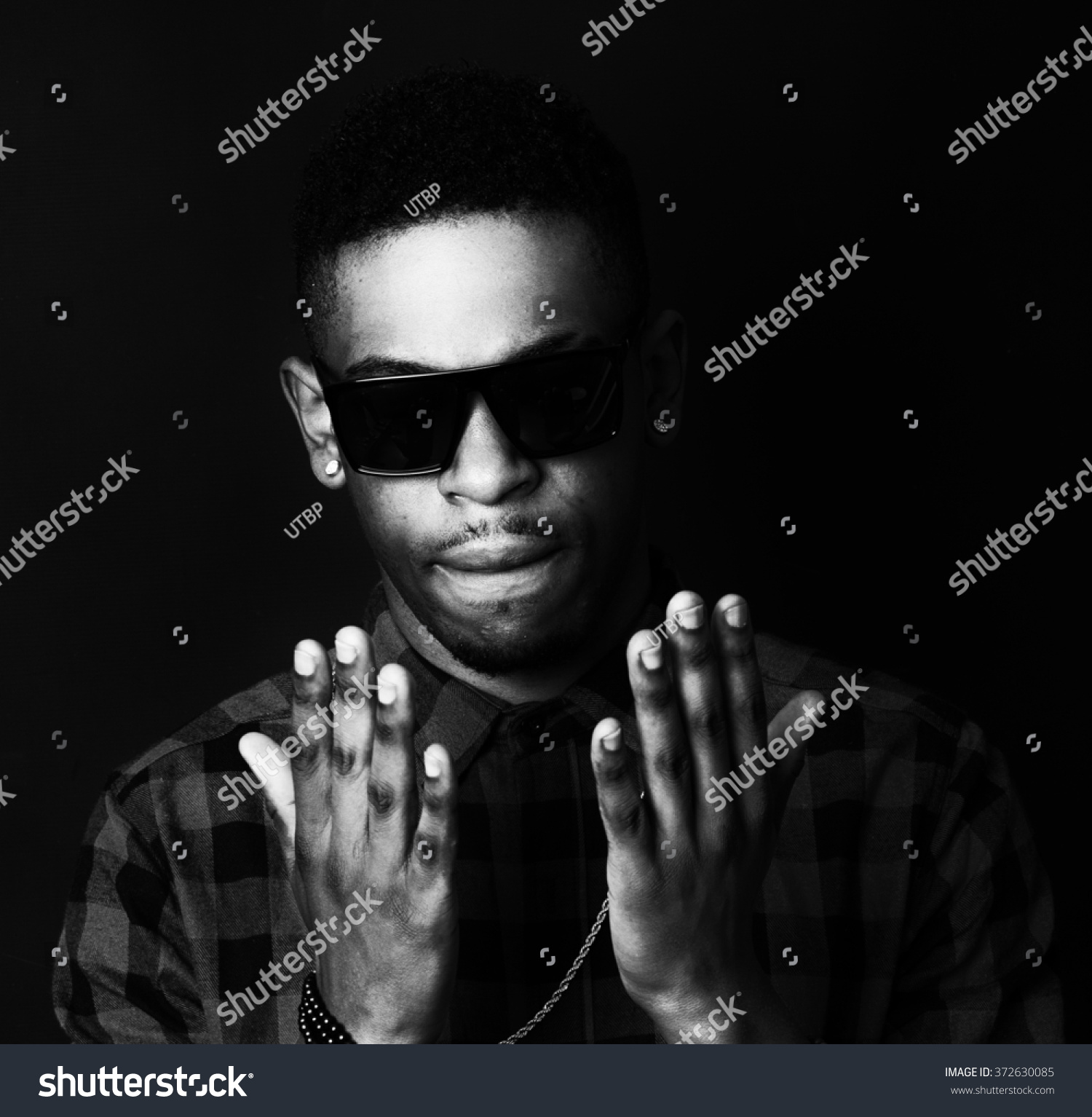 Black and white high contrast african american male man portrait black man with sun glasses