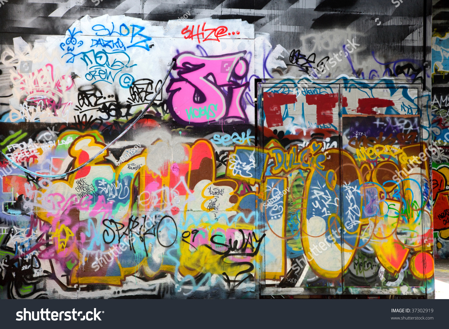 abstract colorful graffiti background in a wall stock