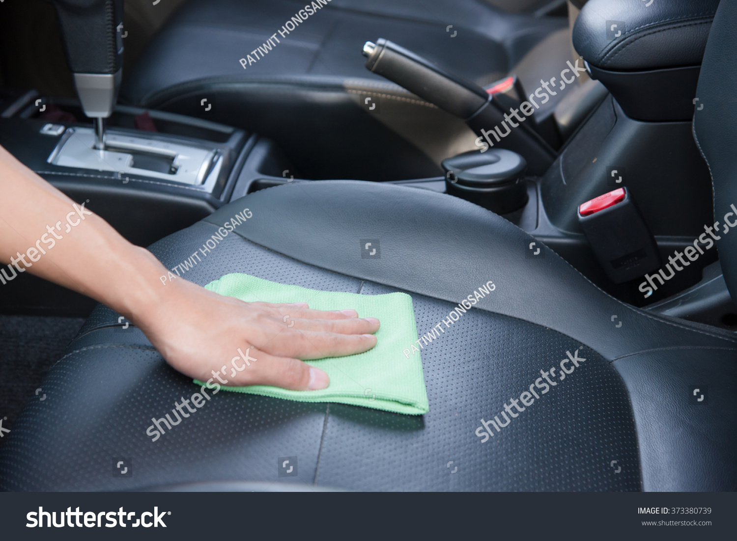 hand cleaning the car interior with green microfiber cloth stock photo 373380739 shutterstock. Black Bedroom Furniture Sets. Home Design Ideas