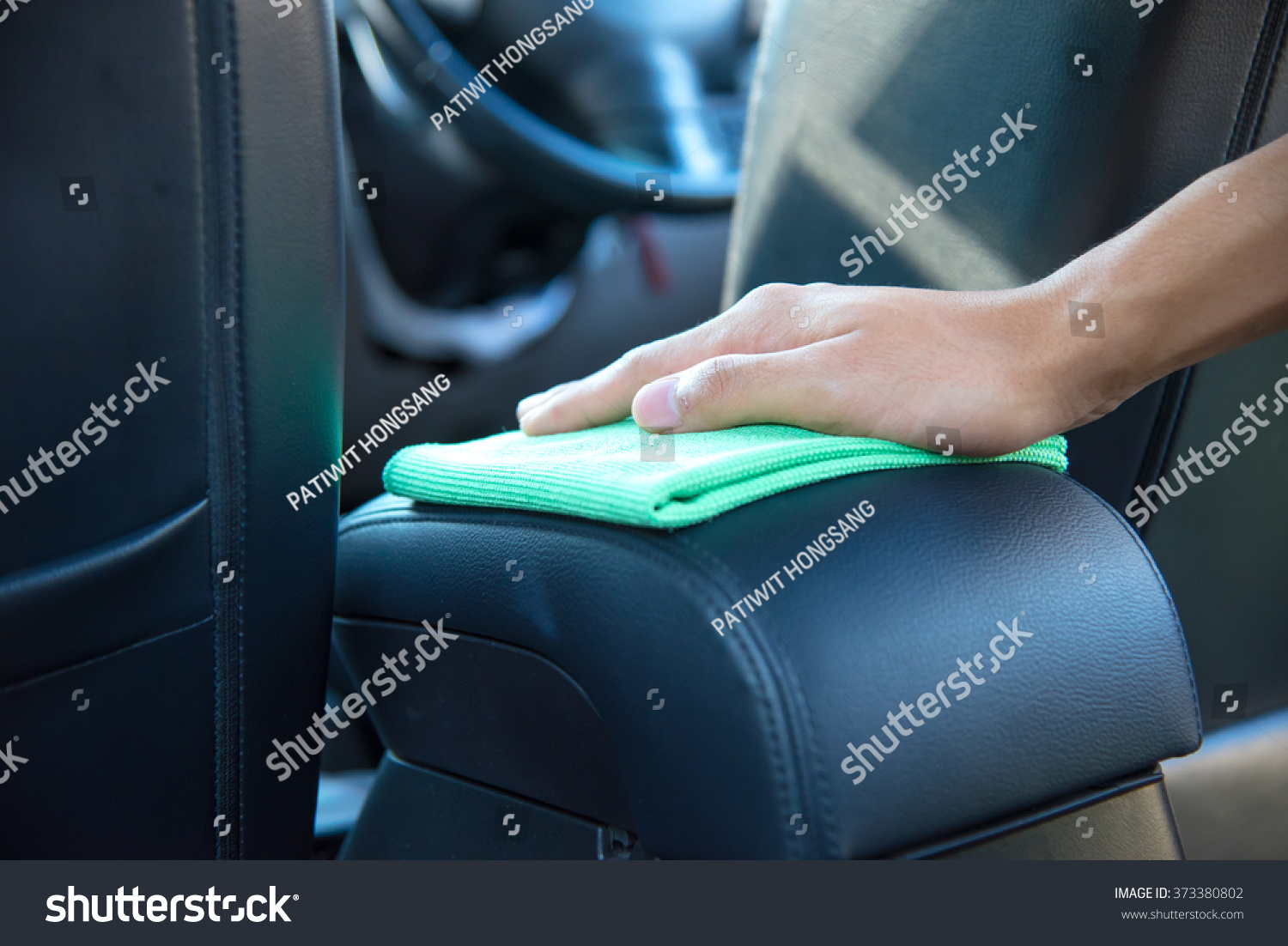 hand cleaning the car interior with green microfiber cloth stock photo 373380802 shutterstock. Black Bedroom Furniture Sets. Home Design Ideas