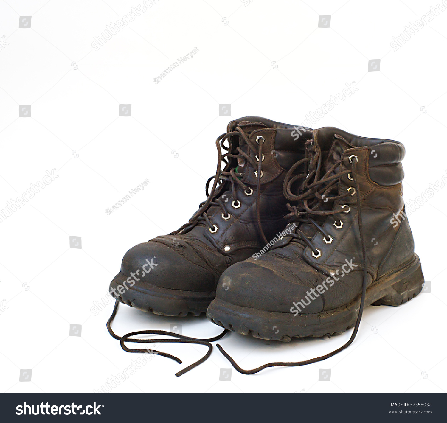 Old Used Work Boots On White Background Stock Photo