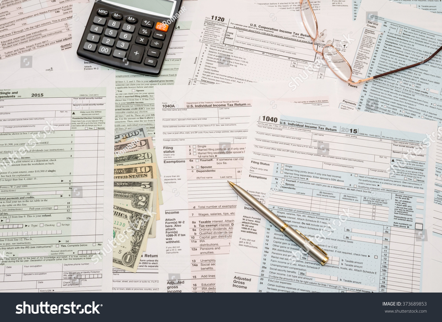 1040 tax form with pen dollar and calculator stock photo for 1040 tax table calculator