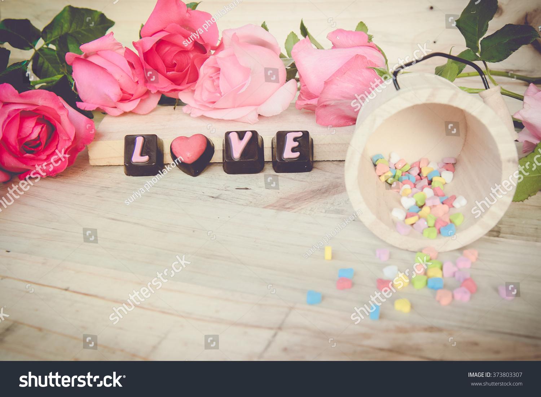 Chocolate Roses On Wood Background Valentines Stock Photo