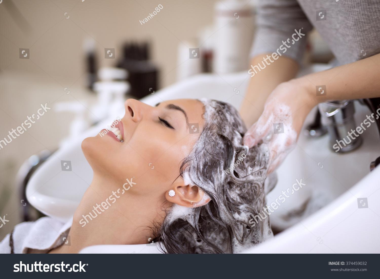 Portrait of women which wash hair in a beauty salon for Wash hair salon
