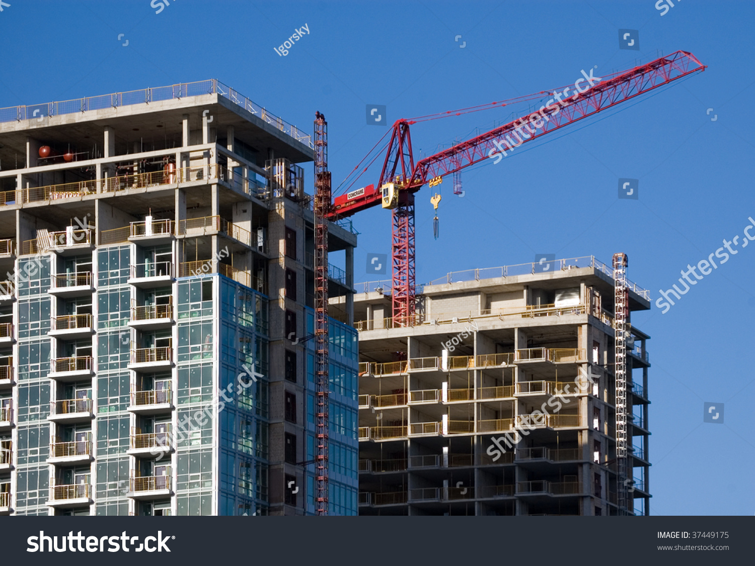 crane on top building construction site stock photo