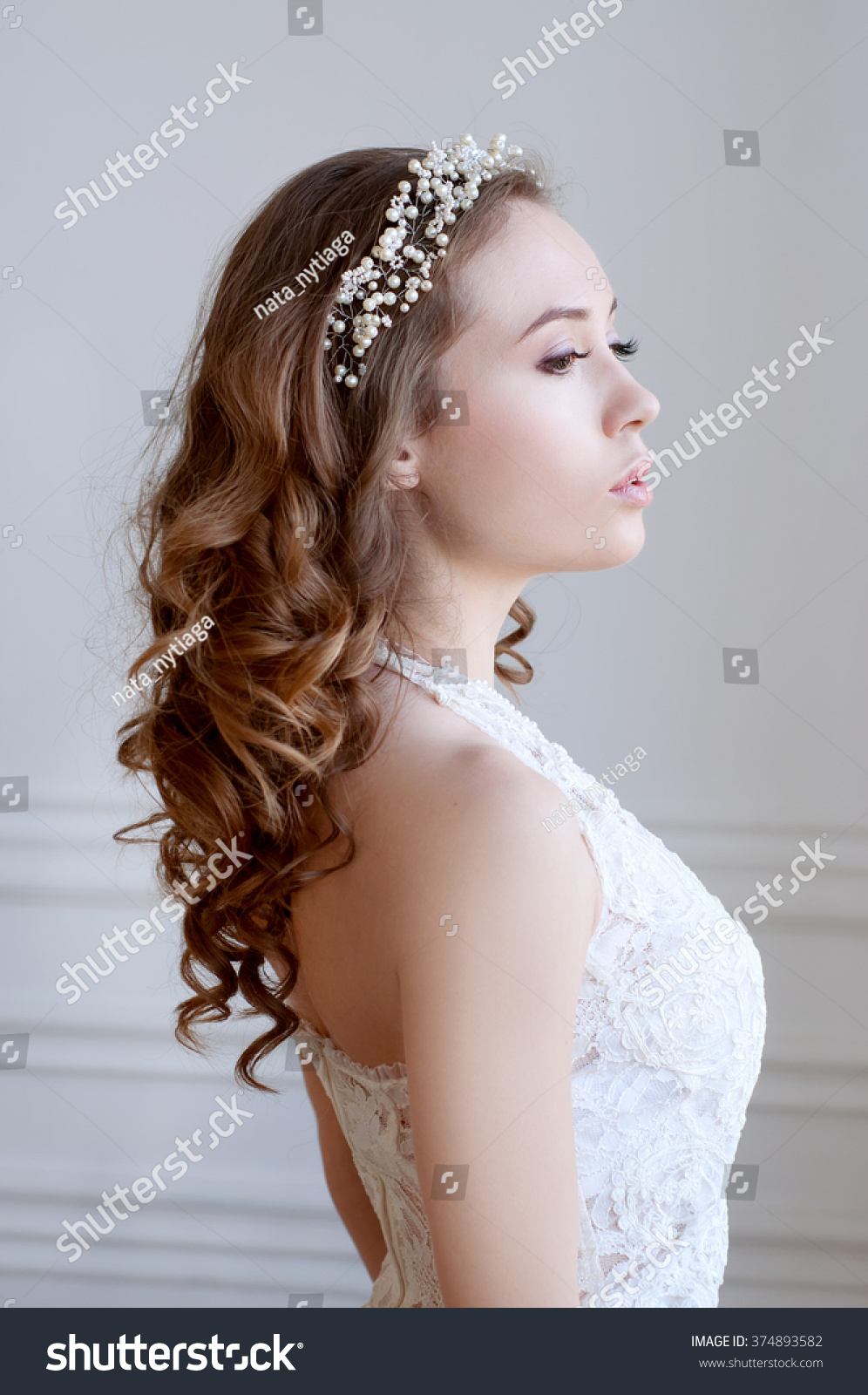 bridal hairstyle and makeup. young woman with long curly brown