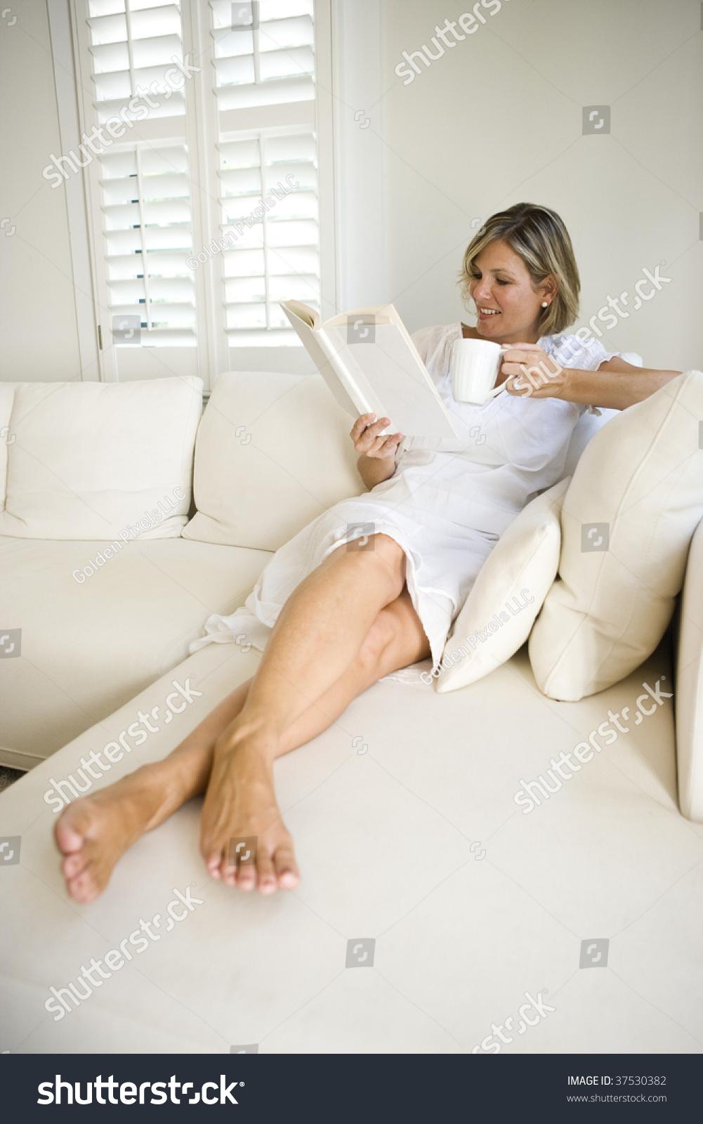 woman relaxingwindow on sofa stock photo (royalty free) 37530382