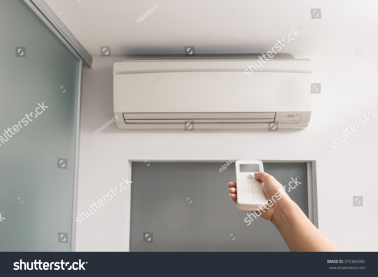 The Air Conditioner In The Room Stock Photo 375360385 : Shutterstock #6D4D3C