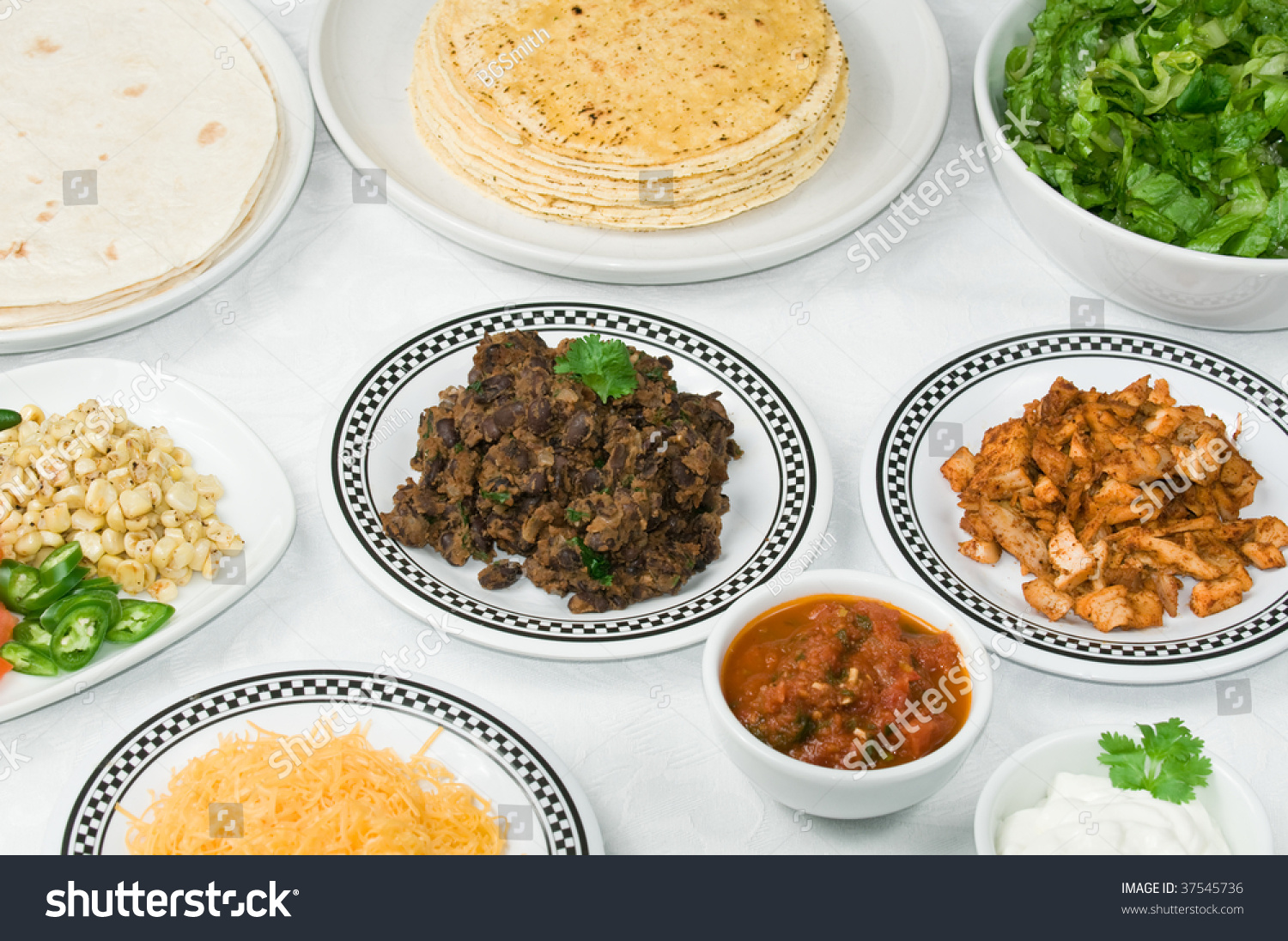 Dinner table with mexican food - Save To A Lightbox