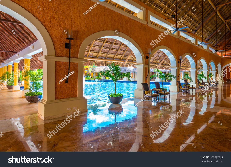 Lobby luxury caribbean tropical hotel resort stock photo for Tropical hotel decor