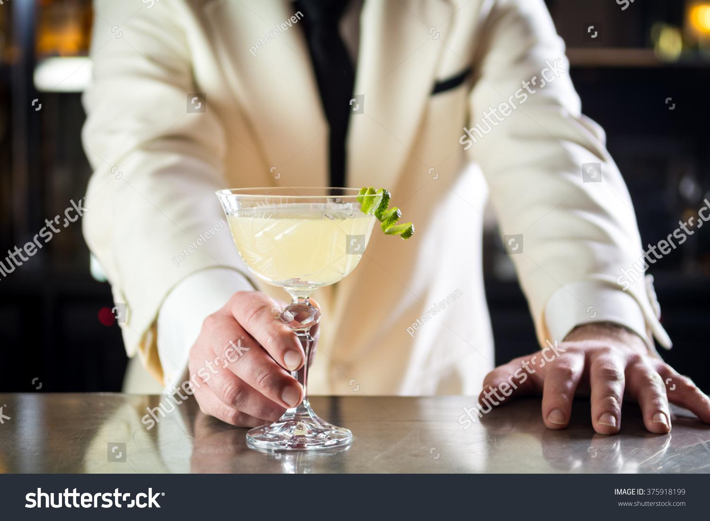 classy bartender barman serves plain classic stock photo 375918199
