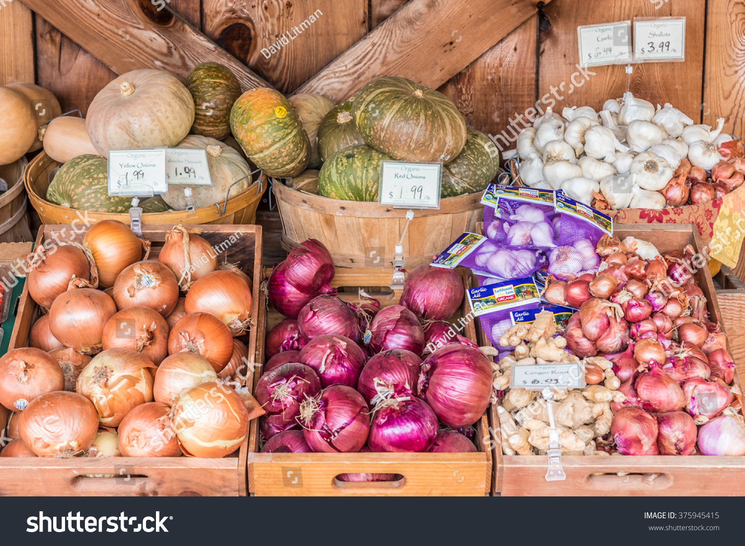 Carmel Valley, California, USA - February 11, 2016: Organic onions, garlic and squash is on display at the outdoor farmer's market of Earthbound Farms.