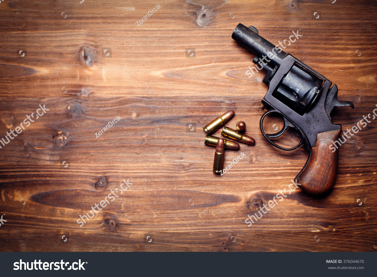 Revolver On The Wooden Table Stock Photo 376044670 ...