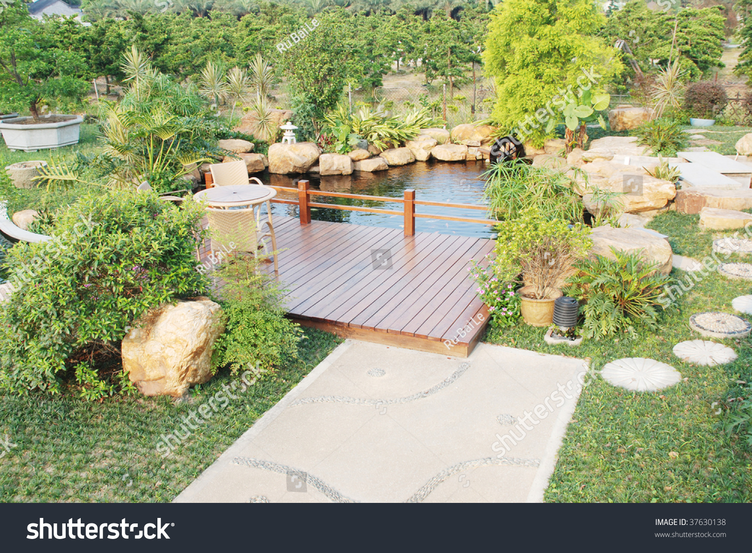 A privat garden with tropical plant and fish pond in south for Outdoor tropical fish pond